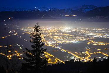 Light and air pollution over the Arve valley shortly before dusk. Shot of January 22, 2020 from the slopes of Mont M?le, Haute-Savoie, France