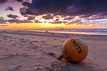 Buoy stranded on the beach of Sangatte, at sunset, Hauts de France