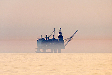Oil platform at sunset in the North Sea off the coast of Scotland