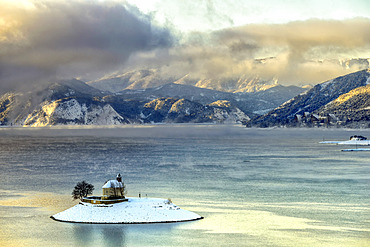 Saint Michael's chapel in winter, Lac de Serre Poncon, Hautes Alpes, France