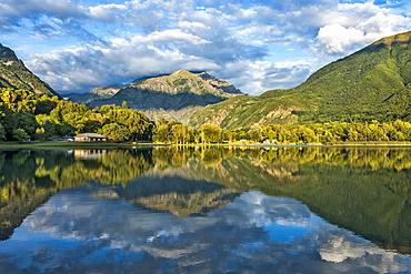 Reflection of the mountains on the lake of Valbonnais, Matheysine, Parc National des Ecrins, Isere, Auvergne Rhone Alpes, France