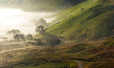 The Old Road in Castleton, UK. An abandoned road winds through the mist in the Peak District, UK.