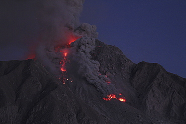 volcano Soufriere Hills volcanic eruption ash cloud pyroclastic power during the evening Montserrat Caribbean