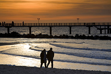 pier of Wustrow at dusk Baltic Sea people 02 walking on beach sunset nature mood Mecklenburg-Vorpommern Germany