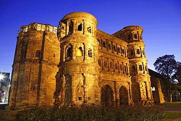 historical city gate Porta nigra illuminated at night