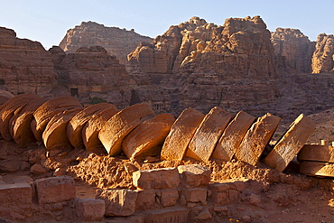 fallen fragmented pillar in old antique Greek temple remnants near city of Petra built into rocks outdoors Jordanian desert Jordan Asia