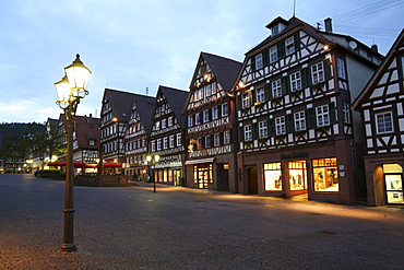 view of market square with half-timbered houses and old historic birthplace of writer and painter Hermann Hesse 1877-1962 cityscape night view Black Forest Baden-Wurttemberg Germany