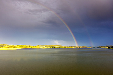 rainbow over water landscape Saxony Germany Europe