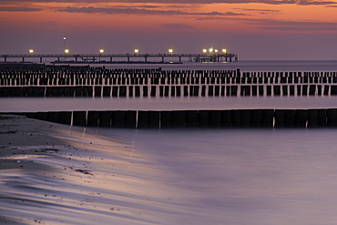 coast water sea groynes and pier at sunset Wustrow Peninsula Darvü-Fischland Mecklenburg-Western Pomerania