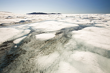 Melt water on the Greenland ice sheet which is melting at an unprecedented rate due to human-induced climate change, near Camp Victor north of Ilulissat, Greenland, Polar Regions