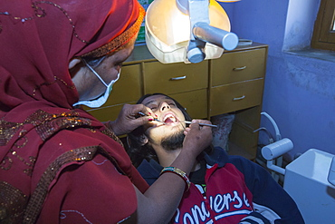 A Barefoot Dentist, who is trained to perform basic dentistry at the Barefoot College in Tilonia, Rajasthan, India. The Barefoot College is a worldwide charity, founded by Bunker Roy, its aims are, education, drinking water, electrification through solar power, skill development, health, women empowerment and the upliftment of rural people.