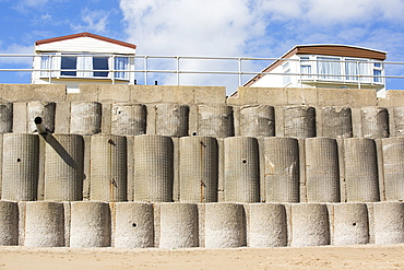 Concrete sea defences at Beach Bank Caravan Park in Ulrome near Skipsea on Yorkshires East Coast, UK. The coast is composed of soft boulder clays, very vulnerable to coastal erosion. This section of coast has been eroding since Roman times, with many villages having disappeared into the sea, and is the fastest eroding coast in Europe. Climate change is speeding up the erosion, with sea level rise, increased stormy weather and increased heavy rainfall events, all playing their part.