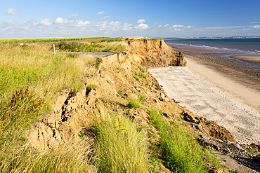 A collapsed coastal road at near Aldbrough on Yorkshires East Coast, near Skipsea, UK. The coast is composed of soft boulder clays, very vulnerable to coastal erosion. This sectiion of coast has been eroding since Roman times, with many villages having disappeared into the sea, and is the fastest eroding coast in Europe. Climate change is speeding up the erosion, with sea level rise, increased stormy weather and increased heavy rainfall events, all palying their part.