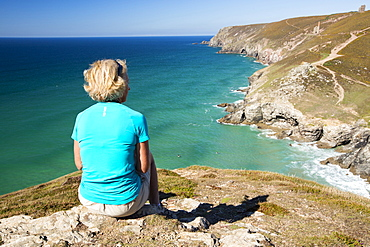 A woman above Chapel Porth on the Cornish coast, near St Agnes.