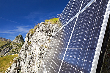 Solar panels attached to a cliff above the Refuge Bertone, which provied electricity to this off grid mountain hut.