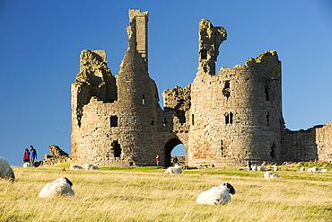 Dunstanburgh castle on Northumberlands coast near Craster.