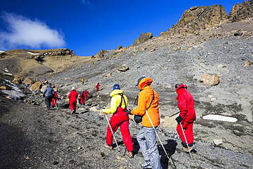 Passengers on an expedition cruise climbing the caldera on Deception Island in the South Shetland Islands off the Antarctic Peninsular which is an active volcanic.