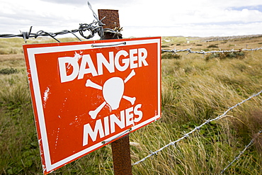 A warning sign about the presence of Argentinian mines on the Falkands, left over from the 1980's Falklands conflict when Argentina invaded the islands.