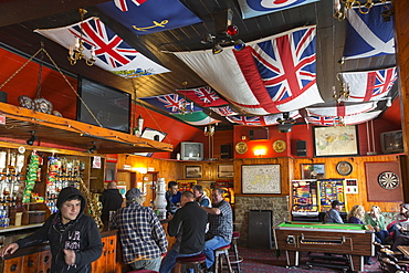 Drinkers in the Globa Tavern in Port Stanley, the capital of the Falkland Islands.