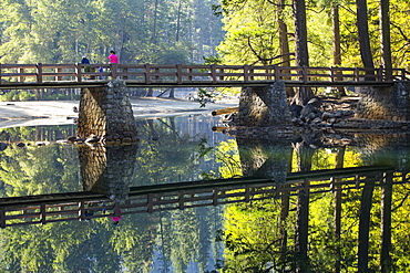 Reflections and a bridge crossing the Merced River, Yosemite Valley, Yosemite National Park, California, USA.