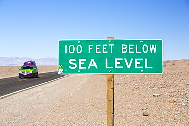 A sign at 100 feet below sea level in Death Valley which is the lowest, hottest, driest place in the USA, with an average annual rainfall of around 2 inches, some years it does not receive any rain at all.