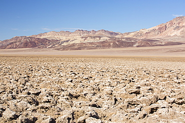 The Devils Golf Course in Death Valley which is the lowest, hottest, driest place in the USA, with an average annual rainfall of around 2 inches, some years it does not receive any rain at all.