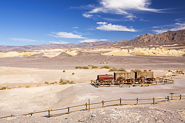 An old wagon train at the Harmony Borax works in Death Valley which is the lowest, hottest, driest place in the USA, with an average annual rainfall of around 2 inches, some years it does not receive any rain at all.