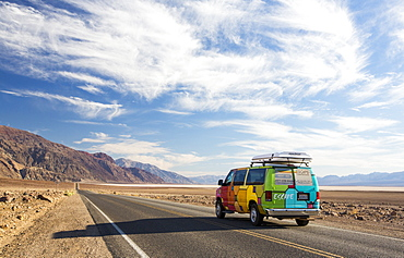 An RV on the road near Badwater which is the lowest point in the USA being 282 feet below sea level in Death Valley. Death Valley is the lowest, hottest, driest place in the USA, with an average annual rainfall of around 2 inches, some years it does not receive any rain at all.