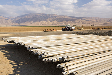 Irrigation pipes in California's Central Valley, which is in the grip of a four year long drought. The catastrophic drought means that no crops will grow without increasingly scarce irrigation water. Many areas of farmland have been abandoned due to the drought.
