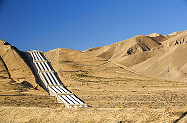 A pumping station sends water uphill over the mountains on the California aquaduct that brings water from snowmelt in the Sierra Nevada mountains to farmland in the Central Valley. Following a four year long catastrophic drought, irrigation water is in short supply, with $2 billion annually wiped off the agricultre sector.