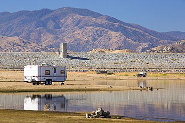 An RV that until recently would be 40 feet underwater on the lake bed of Lake Isabella near Bakersfield, East of California's Central valley which is at less than 13% capacity following the four year long devastating drought. The reservoir has dropped so low, that the water level is below the outflow pipe.