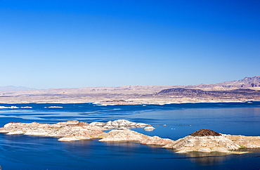 Lake Mead, Nevada, USA. The lake is at a very low level due to the four year long drought, with the boundary of where the water used to reach, clearly visible.