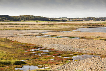 Damage caused to the coastal defences by the December 2013 storm surge at Cley on the North Norfolk coast, UK. The huge waves completely breached the storm beach, and pushed it inland onto the Cley nature reserve.