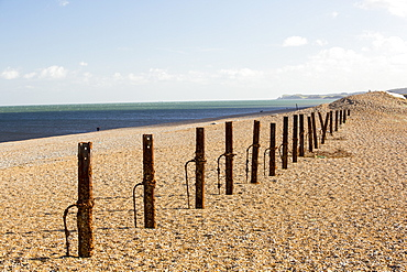 Second World war defences that for a long time were buried under the storm beach are revealed after the December 2013 storm surge at Cley on the North Norfolk coast, UK. The huge waves completely breached the storm beach, and pushed it inland onto the Cley nature reserve.