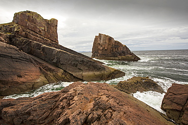 The famous split rock of Clachtoll in Clachtoll, Assynt, Noth West Highlands, Scotland, UK.