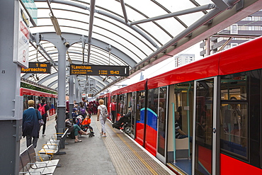 A Docklands Light Railway train (DLR) at a station near Canary wharf, London, UK.