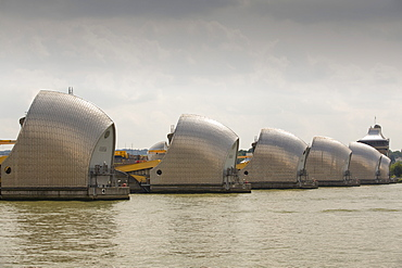 The Thames barrier on the River Thames in London. It was constructed to protect the capital city from storm surge flooding. Recent predictions show it will probably be redundant in around twenty years due to increased stormy weather and sea level rise driven by climate change.