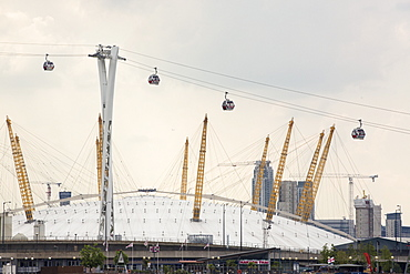 The O2 Arena and the Emirates air line cable car on the Royal Victoria Dock, London, UK.