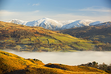 Looking towards the Kentmere fells from Loughrigg above valley mist from a temperature inversion, Lake District, UK.