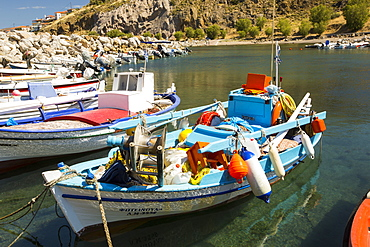 Traditional Greek wooden fishing boats in the harbour at Skala Eresou on Lesvos, Greece.