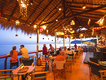 A seafront cocktail bar in Skala Eresou, Lesbos, Greece at sunset.