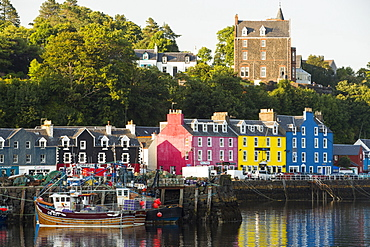 The iconic promenade of Tobermory on the Isle of Mull, Scotland, UK, with its colouful painted shops.