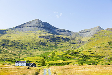 An isolated house beneath Ben More on the Isle of Mull, Scotland, UK.
