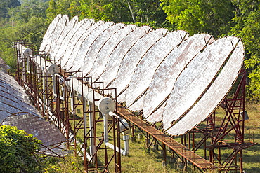 The Muni Seva Ashram in Goraj, near Vadodara, India, is a tranquil haven of humanitarian care. The Ashram is hugely sustainable, next year it will be completely carbon neutral. Its first solar panels were installed in 1984, long before climate change was on anyones agenda. Their energy is provided from solar panels, and wood grown on the estate. Waste food and animal manure is turned inot biogas to run the estates cars and also used for cooking. Solar cookers are also used, and the air conditioning for the hospital is solar run. 70 % of the food used is grown on the estate. They provide an orphanage, schools for all ages, vocational training, care for the elderly, a specialist cancer hospital withstate of the art machinary, and even have a solar crematorium. This shot shows the solar air conditioning for the Ashram's hospital.