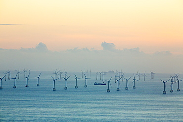 An offshore wind farm and gas platfroms in morecame bay from the summit of Black Combe, Cumbria, UK.