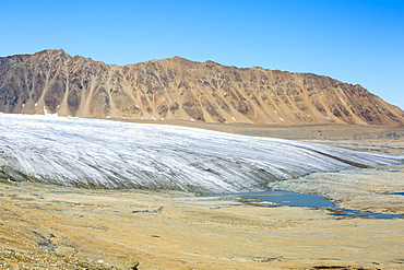 A glacier at Recherchefjorden on Western Svalbard with moraine showing the massive rate of retreat in the last 100 years.. All of Svalbards glaciers are retreating, even in the north of the archiapelago despite only being around 600 miles from the North Pole.