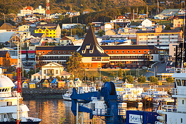 Sunrise over ships in the harbour of Ushuaia which is the capital of Tierra del Fuego, in Argentina, it is the most southerly city in the world and the starting point for trips to Antarctica.