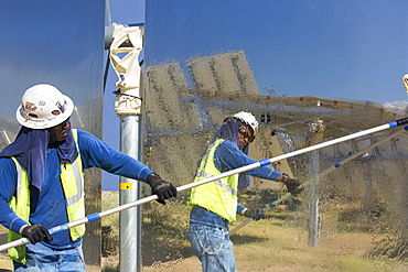 Workers washing the heliostats to maximise reflective power at the Ivanpah Solar Thermal Power Plant in California''s Mojave Desert is currently the largest solar thermal plant in the world. It generates 392 megawatts (MW) and deploys 173,500 heliostats that reflect the suns rays onto three solar towers. It covers 4,000 acres of desert.