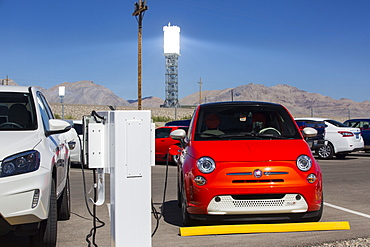 Electric cars being recharged at the Ivanpah Solar Thermal Power Plant in California''s Mojave Desert is currently the largest solar thermal plant in the world. It generates 392 megawatts (MW) and deploys 173,500 heliostats that reflect the suns rays onto three solar towers. It covers 4,000 acres of desert.