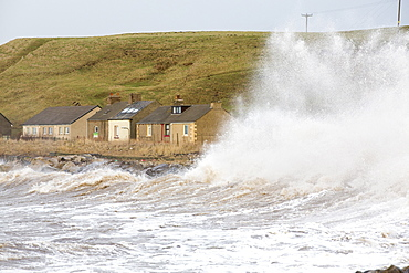 Waves crashing off Parton near Whitehaven during the January 2014 period of storm surge, high tides and storm force winds. The coastline took a battering, damaging the harbour wall and eroding a large section of coastal cliff.
